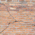 Brick building with cracked foundation